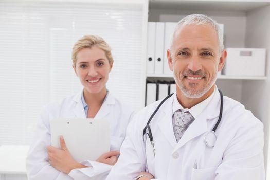 Smiling doctors coworker standing
