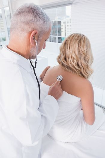 Doctor listening the breathing at his patient