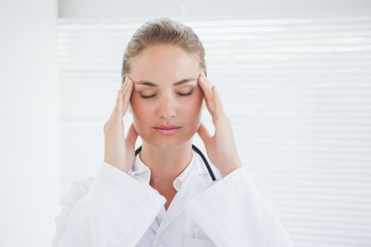 Doctor suffering from a migraine