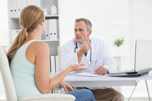 Concerned doctor talking to his patient