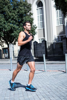 Determined handsome athlete jogging