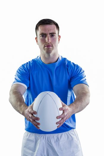 Rugby player handing a rugby ball