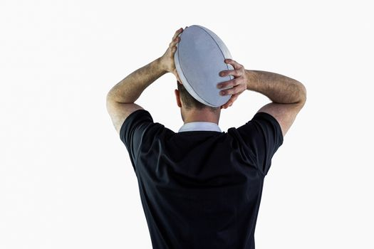 Rugby player about to throw a rugby ball