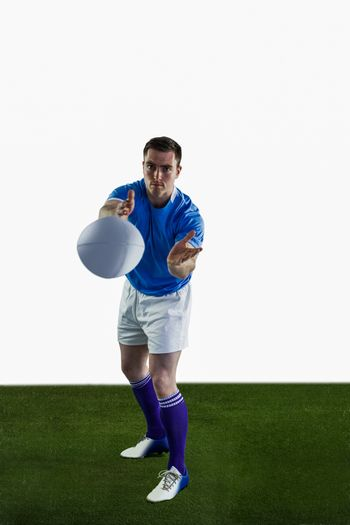 Rugby player throwing a rugby ball