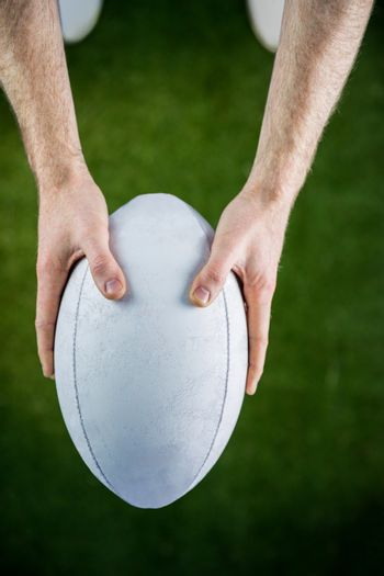 Rugby player catching a rugby ball