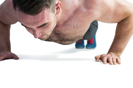 Strong bodybuilder doing press up