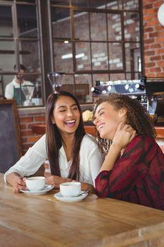 Female friends having coffee