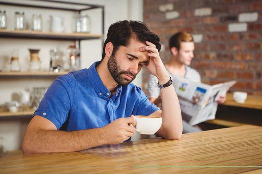 Worried man drinking a coffee