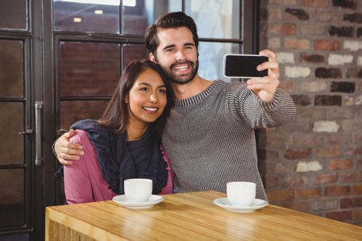 Young happy couple making a selfie