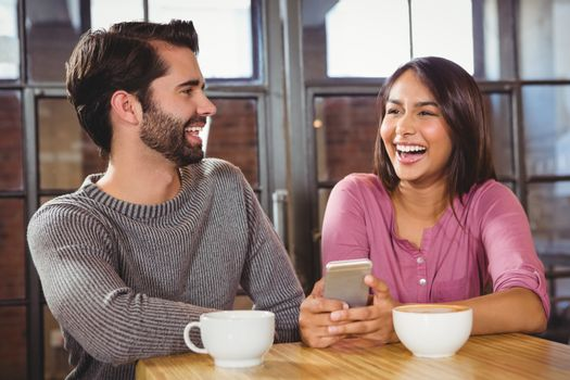 Cute couple looking at a smartphone