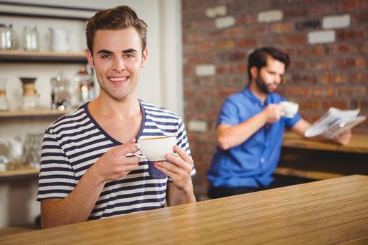 Happy man drinking a coffee