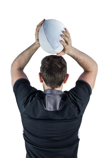 Back turned rugby player throwing a ball