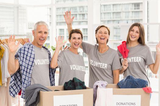Smiling volunteers waving