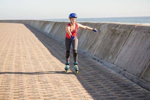 Carefree sporty blonde skating
