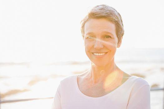 Smiling sporty woman at promenade