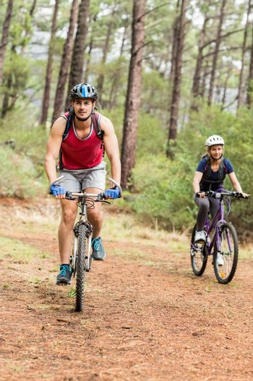 Pretty biker couple biking