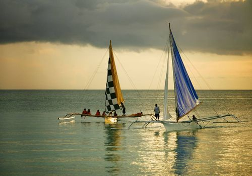 Boracay, Phillipines - October 20, 2008: Two Filipino traditional sailing on the open ocean. Boracay Island