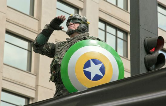 SAO PAULO, BRAZIL August 16, 2015: An unidentified man dressed as a super hero with colors yellow and green in the protest against federal government corruption in Sao Paulo Brazil.