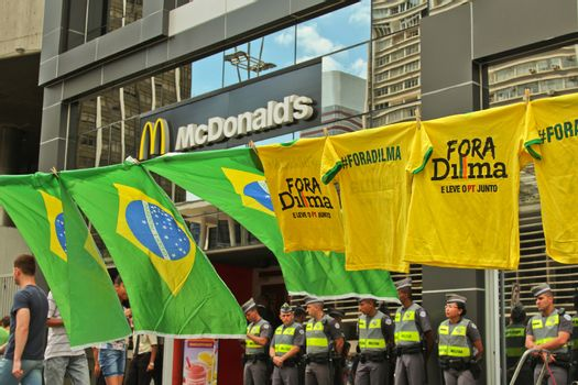 SAO PAULO, BRAZIL August 16, 2015: Flags and T-Shirts to sell in the protest against federal government corruption in Sao Paulo Brazil. Protesters call for the impeachment of President Dilma Rousseff.