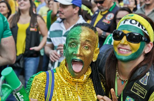 SAO PAULO, BRAZIL August 16, 2015: Two unidentified women  in the protest against federal government corruption in Sao Paulo Brazil.