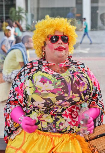 SAO PAULO, BRAZIL August 16, 2015: An unidentified man with Drag Queen costume in the protest against federal government corruption in Sao Paulo Brazil.