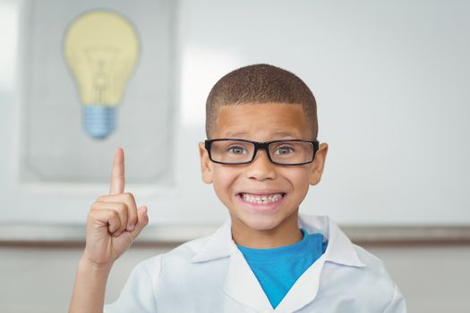 Smiling pupil with lab coat having an idea