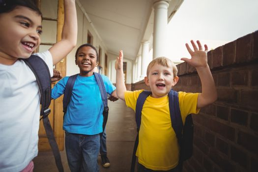 Happy pupils leaving the classroom