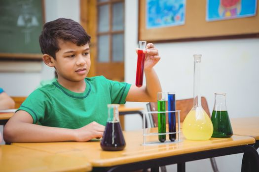 Student using lab glassware