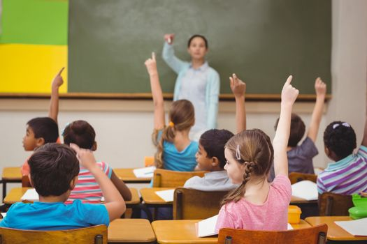Teacher asking a question to her class