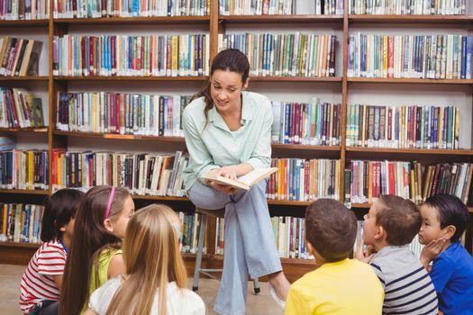 Teacher reading her pupils a story