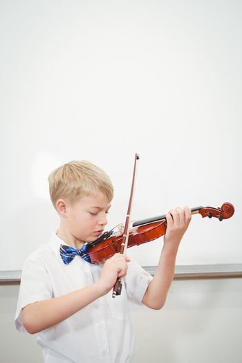 Concentrating Student playing a violin
