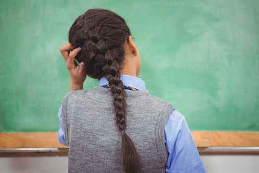 Puzzled student scratching their head