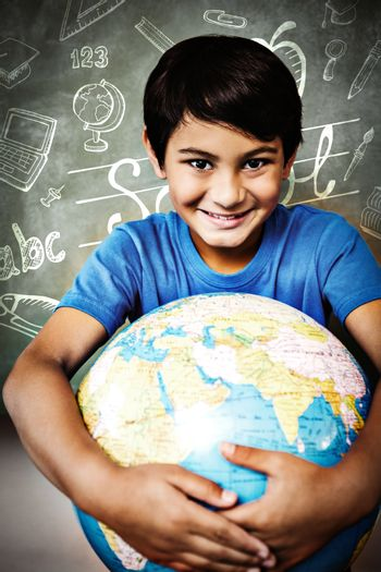 Education doodles against cute little boy holding globe