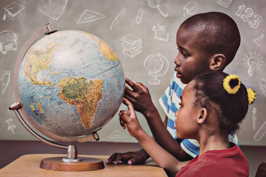 Education doodles against kids pointing at globe in classroom