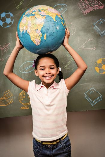 Education doodles against cute little girl holding globe over head