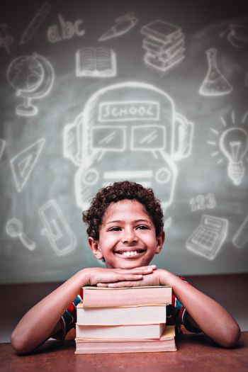 Education doodles against little boy with stack of books in classroom
