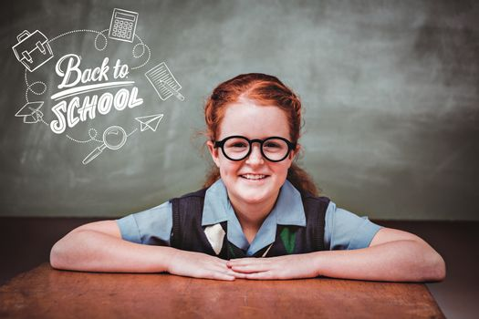 back to school against cute little girl smiling in classroom