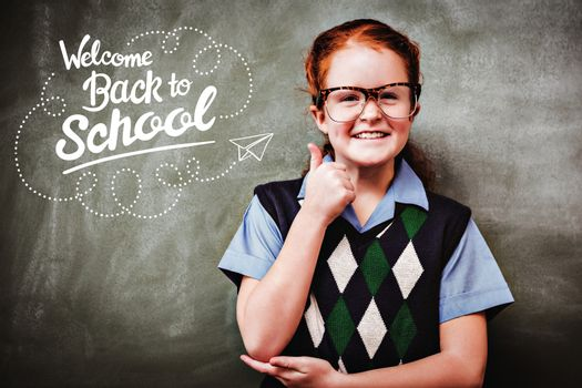 back to school against portrait of cute little girl gesturing thumbs up