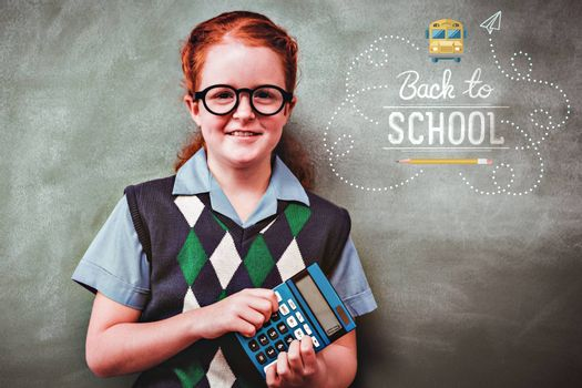 back to school against portrait of cute little girl holding calculator