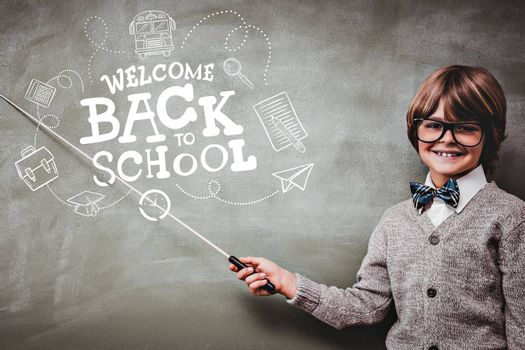 back to school against boy holding stick in front of blackboard