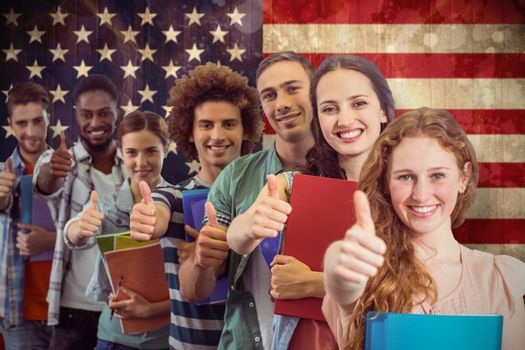 Fashion students smiling at camera together against usa flag in grunge effect