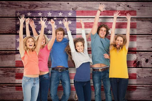 Celebrating friends jumping in the air against composite image of usa national flag