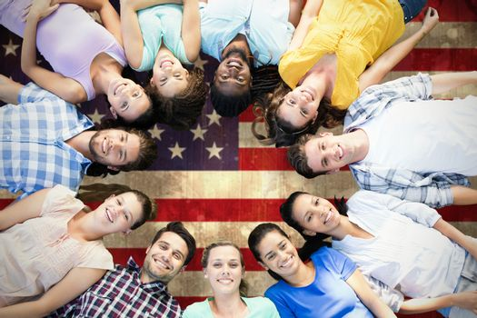 Composite image of happy friends lying in circle