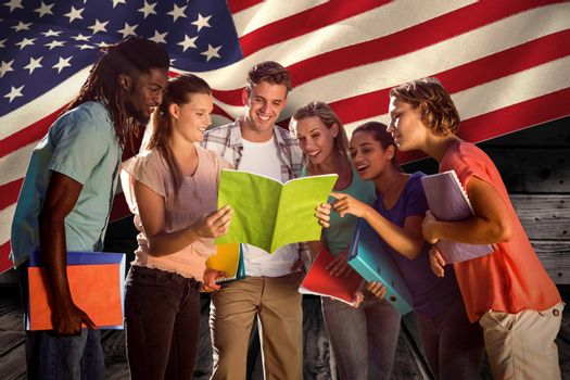 Happy students outside on campus  against composite image of digitally generated united states national flag