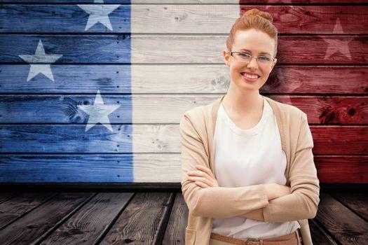 Smiling teacher against composite image of usa national flag