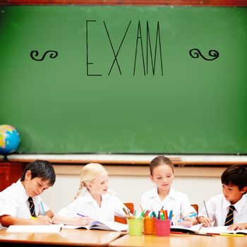The word exam against cute pupils sitting at desk