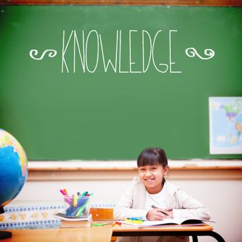 The word knowledge against cute pupil sitting at desk