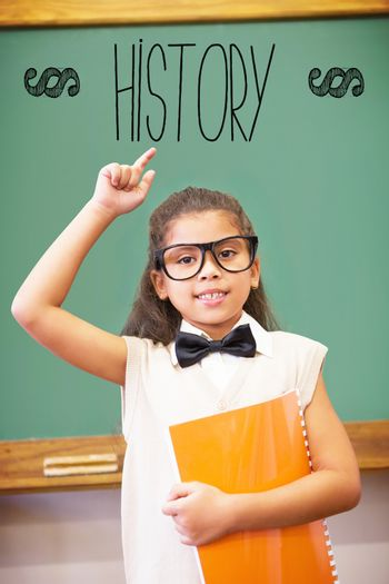 History against cute pupil dressed up as teacher in classroom