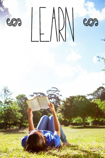 Learn against pretty woman reading in the park