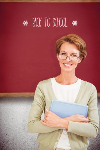 The word back to school and teacher holding tablet pc at library against red background